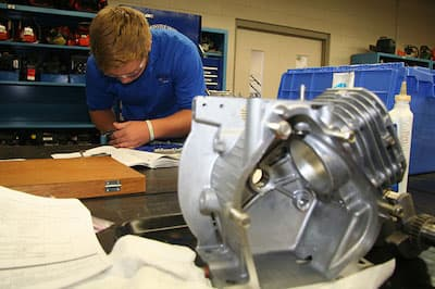 Student working on small engine